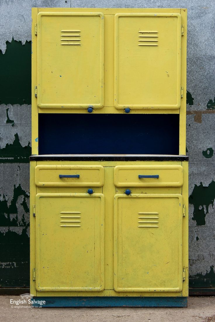 1950's aluminium storage unit, painted yellow and blue, 2 top and 2 bottom cupboards (each with 2 shelves) - it also has two useful drawers.  Within 1 of the top cupboards is an egg shelf.  Possibly a larder as the cupboards have fly vents / screens attached.