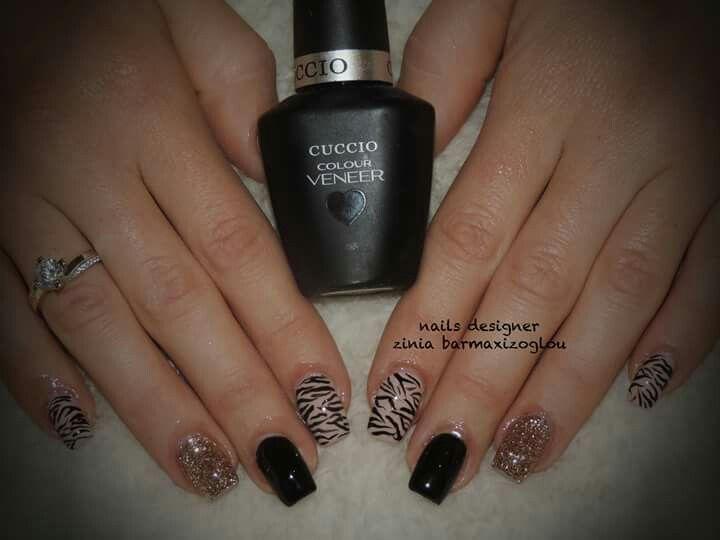 Black nails with zebra nail art