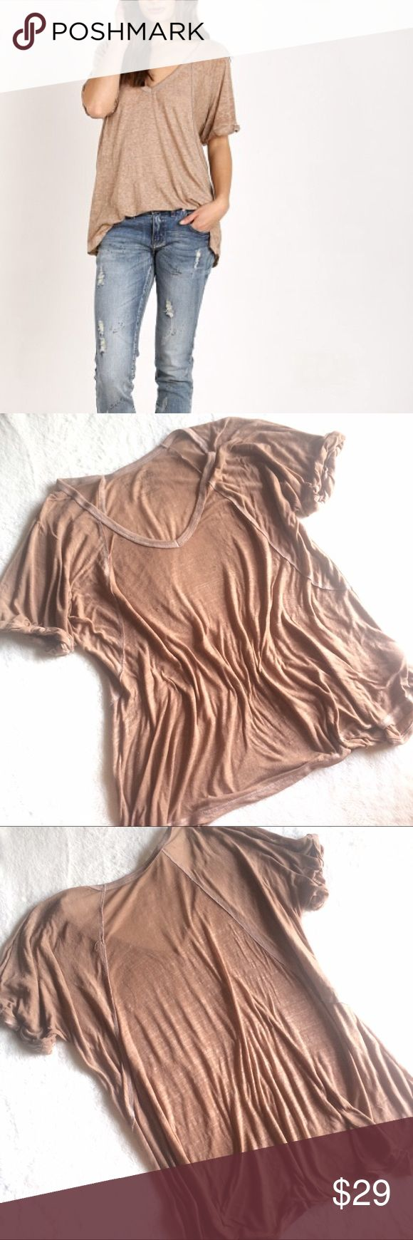 Free People We The Free Free Fallin Tee NWT Free People We The Free Free Fallin Tee in light brown, driftwood. New twist on an old FP fave, this tee features the same slouchy, oversized fit but it's in a so-soft burnout jersey. Ribbed V-Neck with rolled short sleeves. Subtle Hi-Lo hem. Perfectly distressed, all-American styles. We The Free is an exclusive, in-house label. 50% Polyester 38% Cotton 12% Rayon Free People Tops Tees - Short Sleeve