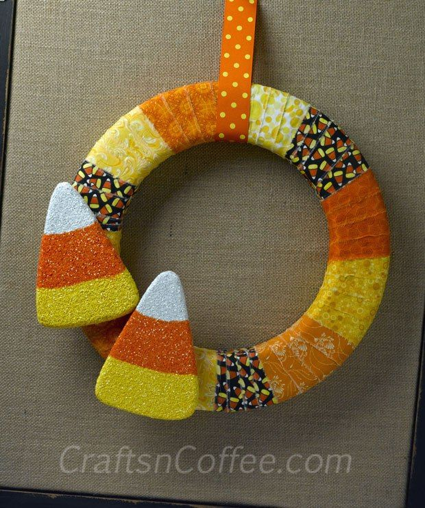Love this colorful Halloween wreath! The glittered candy corn is so sweet. Tutorial on CraftsnCoffee.com.