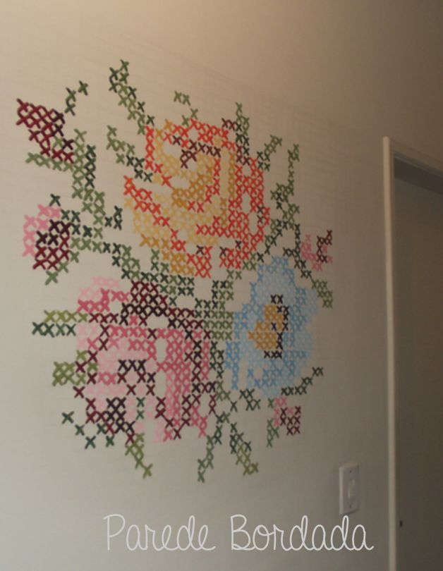cross stitch flowers painted on a wall