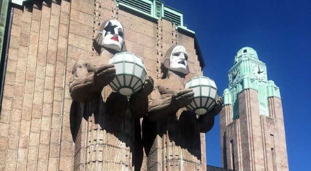 Iconic Helsinki Railway Statues Adorned With KISS Masks