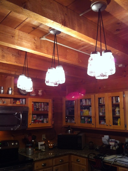 Canning jars light our cabin.