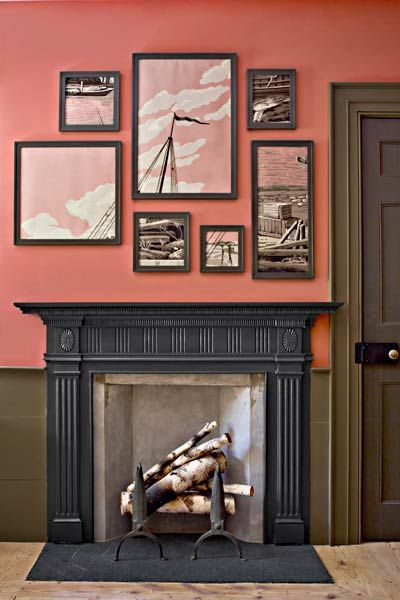 Coordinating paint and wall art make for a cohesive statement fireplace area. For a similar look, try: Amber Rose (upper wall), Lincoln Cottage Black (mantel), and Amazon Silt (wainscoting and casing), @Valspar | Photo: Eric Piasecki/OTTO