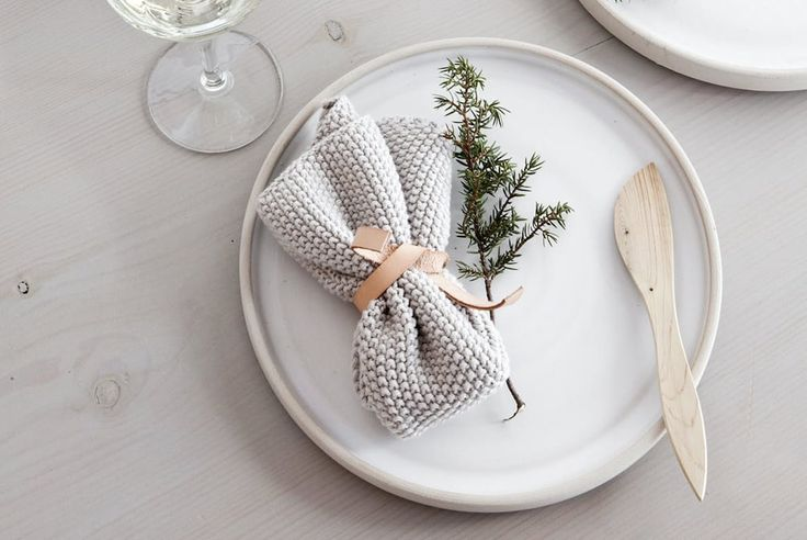 These place settings by Bo Bedre of Norway—minimalist plates, chunky knit napkins, scrap leather ties, and tiny trees—are chockfull of Scandinavian style.