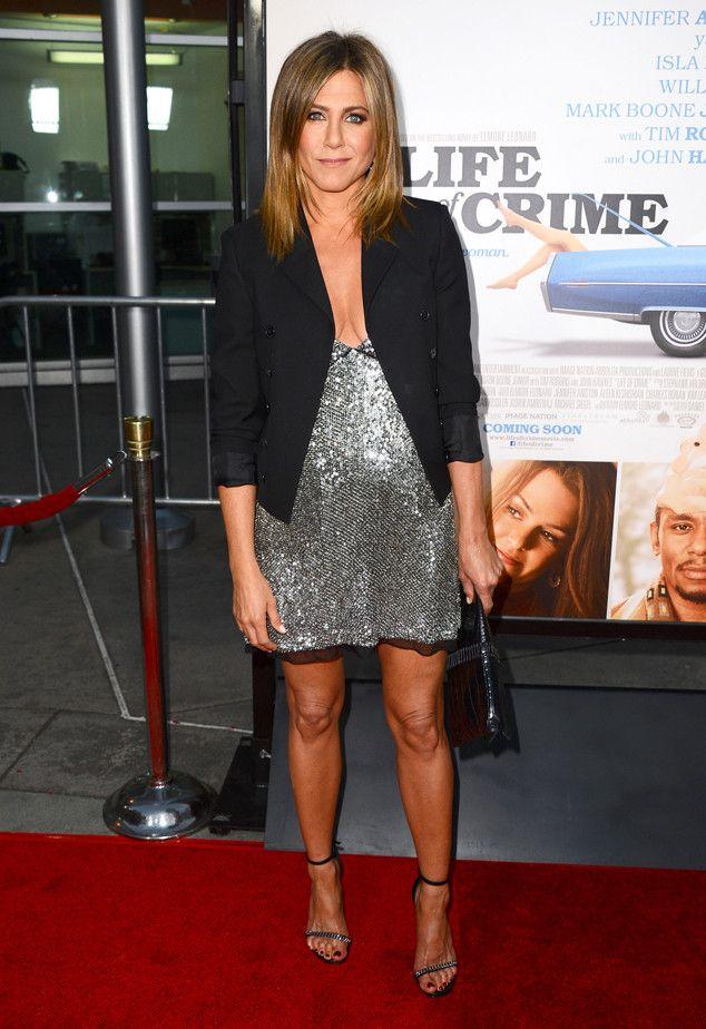 Jennifer Aniston stuns in a silvery, low-cut Saint Laurent minidress!