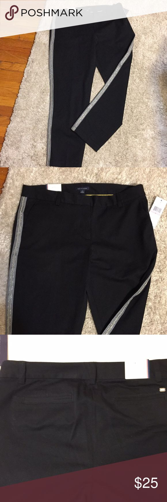 """NWT Tommy Hilfiger Straight LegBlack Pants size 10 NWT Tommy Hilfiger Straight Leg Black Pants.  Size 10. Black with silver 3/4""""  piping on side of pants. Side pockets and on back of pants. Nice pants to wear with silver heels. Dress up of down.  Measurements laying down flat  16"""" Waste  10"""" Rise 26"""" Inseam  7"""" ankle Tommy Hilfiger Pants Straight Leg"""