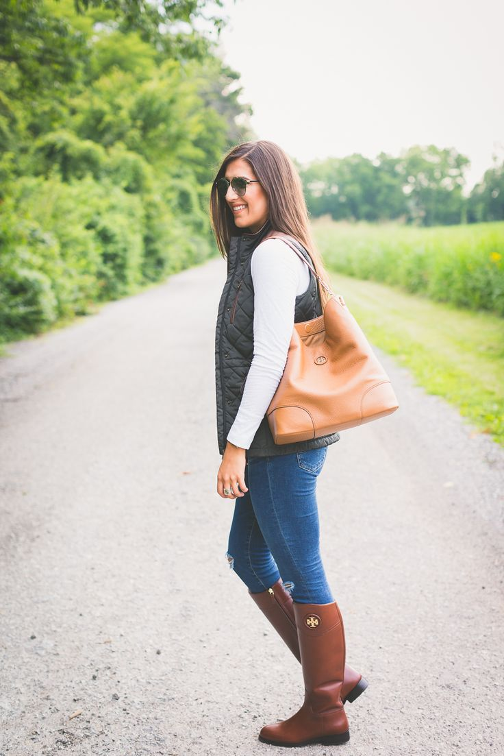 A Southern Drawl. White long sleeve+black quilted vest+ripped jeans+brown riding boots+camel tote bag. Fall outfit 2016