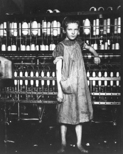 A ten year old spinner in a cotton mill. North Pownal, Vermont, USA, February 1910. Photo: Lewis Wickes Hine.