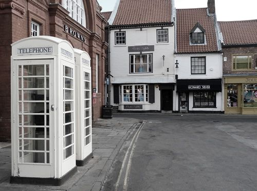 The only place in England to have white telephone kiosks, they were never run by British Telecom but the City Council. Hull, England