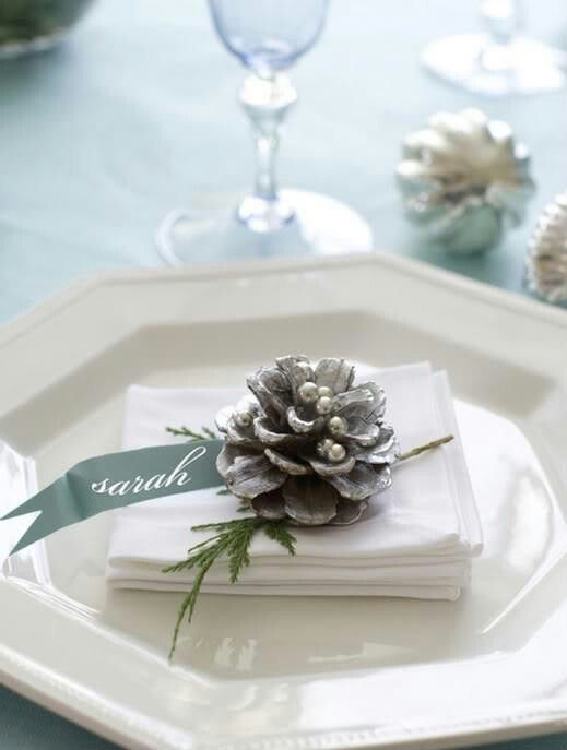 "Christmas place ""card"" - silver tipped pine cone, silver ink on grey-blue ribbon"