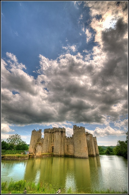 Bodiam Castle, East Sussex, England. Bodiam Castle is a 14th-century moated castle near Robertsbridge in East Sussex, England. It was built in 1385 by Sir Edward Dalyngrigge, a former knight of Edward III. Although the exterior of Bodiam Castle has largely survived, the interior is ruinous.