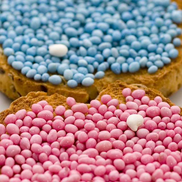 Biscuit with pink or blue toppings. Hard to explain but we call this beschuit met muisjes. This is what we traditionally eat when a child is born, Pink for a girl and blue when its a boy.