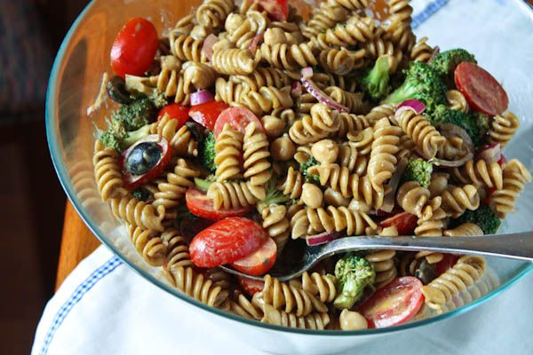 Pasta salad with balsamic basil vinaigrette- has chickpeas, tomatoes, broccoli, olives, red onion...