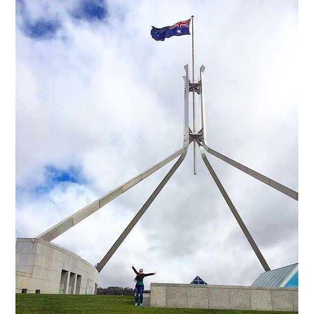 """""""I'm on top of the world! Well on top of the Australian Parliament House at least."""" Instagrammer @rachel_explores shared this awesome snapshot of her on the roof of Parliament House. If you want to try this on your next visit, you just have to take a lift up to the roof of the building for panoramic views of Canberra.  #visitcanberra #CBRbucketlist"""