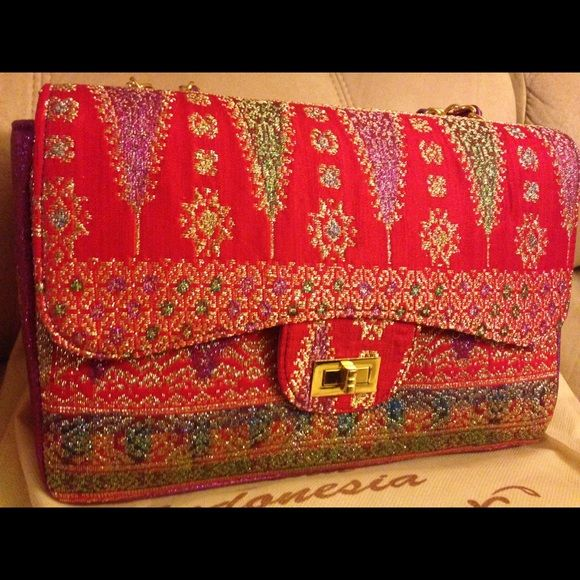 Handbag Brand new Handbag made from BALI SONGKET FABRIC. Traditional fabric from Indonesia ... Very beautiful colors and the SONGKET fabric itself is handmade . Make me an offer Bags Shoulder Bags
