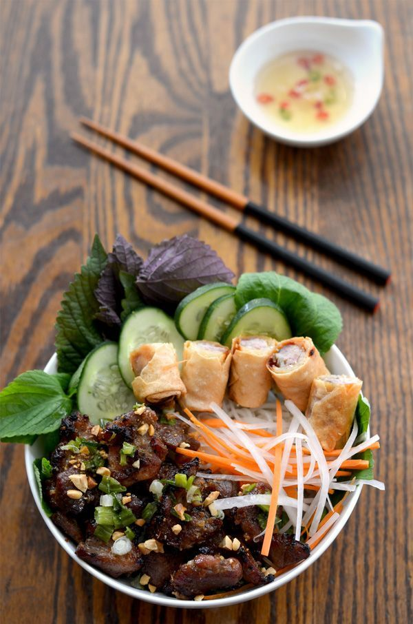 A bowl of Vietnamese grilled pork with vermicelli noodles, eggrolls with fresh and pickled veggies (bun thit nuong) | HungryHuy.com
