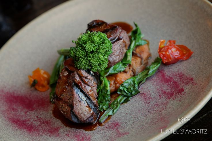 Peppered Wild Fiordland Venison Loin served with kumara & carmelised red onion hash, wilted greens, slow roasted cherry tomatoes, port & prune jus | Hotel St Moritz Queenstown |
