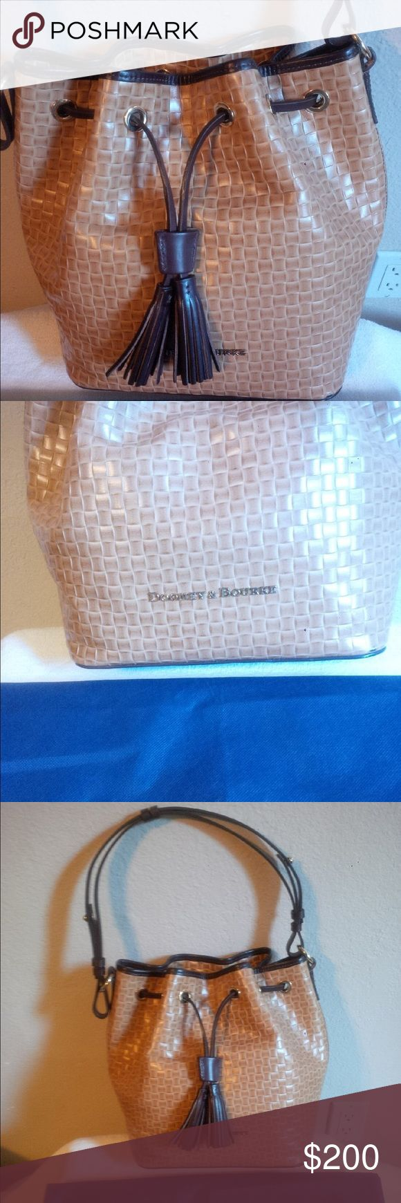 Dooney & Bourne Purse Woven genuine leather. handbag with key keeper and footed bottom comes with sleeper bag. Brand new only carried once. Dooney & Bourke Bags Shoulder Bags