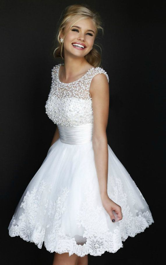 LOVE this for Summer Wedding!  So flirty with gorgeous beading and flair waist.  Ava Lace Short Wedding Dress.   Also cute for homecoming dress or graduation. TheChicFind.com
