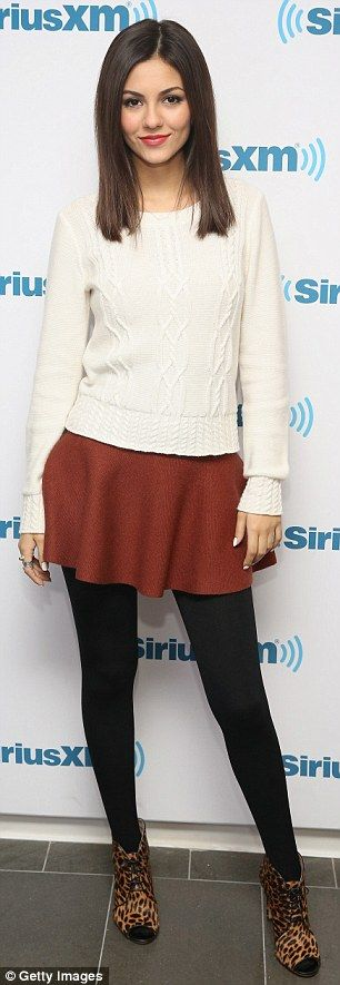 Winter chic: The 21-year-old actress took a walk on the wild side in leopard print ankle b...