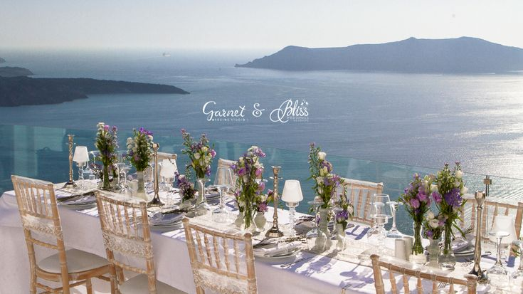 Setting up for Natasha and Andrei's Vintage Lavender Wedding in Santorini