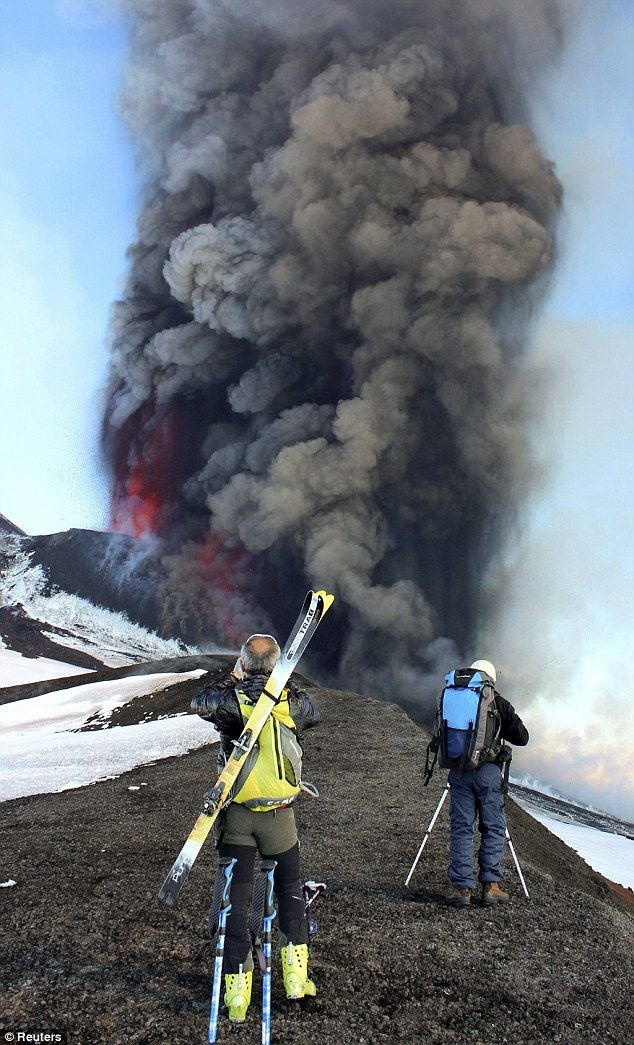 Skiers capture Mount Etna's eruption as it spews lava on the southern Italian island of Sicily