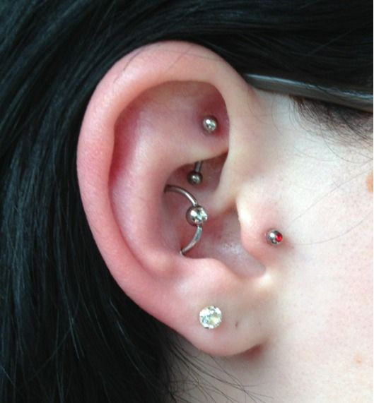 Orbital piercing. ! this one is bitchin'. | plus #tragus double lobes, and #rook |