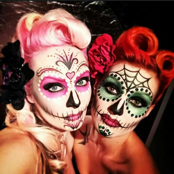 Loving the red hair on the right with this pair of Dia de Muertos