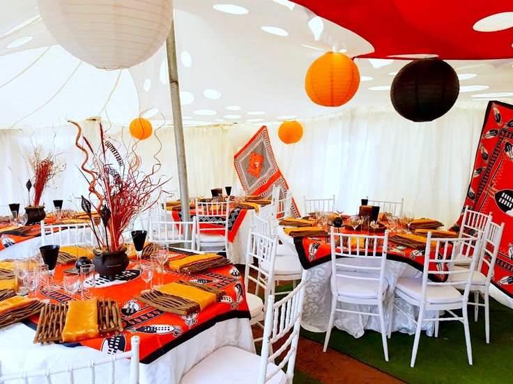 Orange and black traditional wedding decor at Shonga Events
