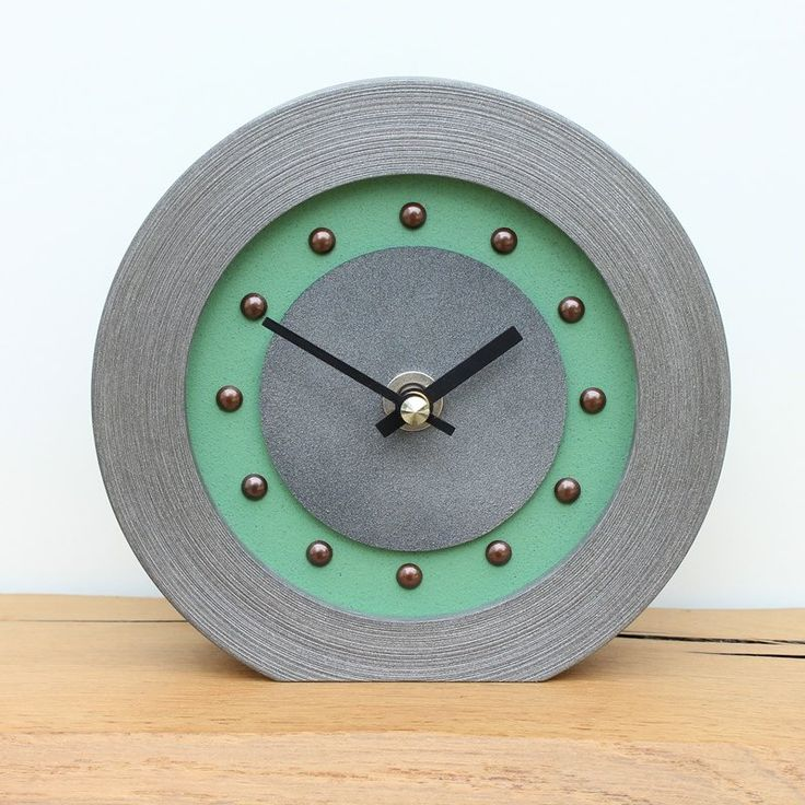 Light Green Mantel Clock with Antique Studs and Hands