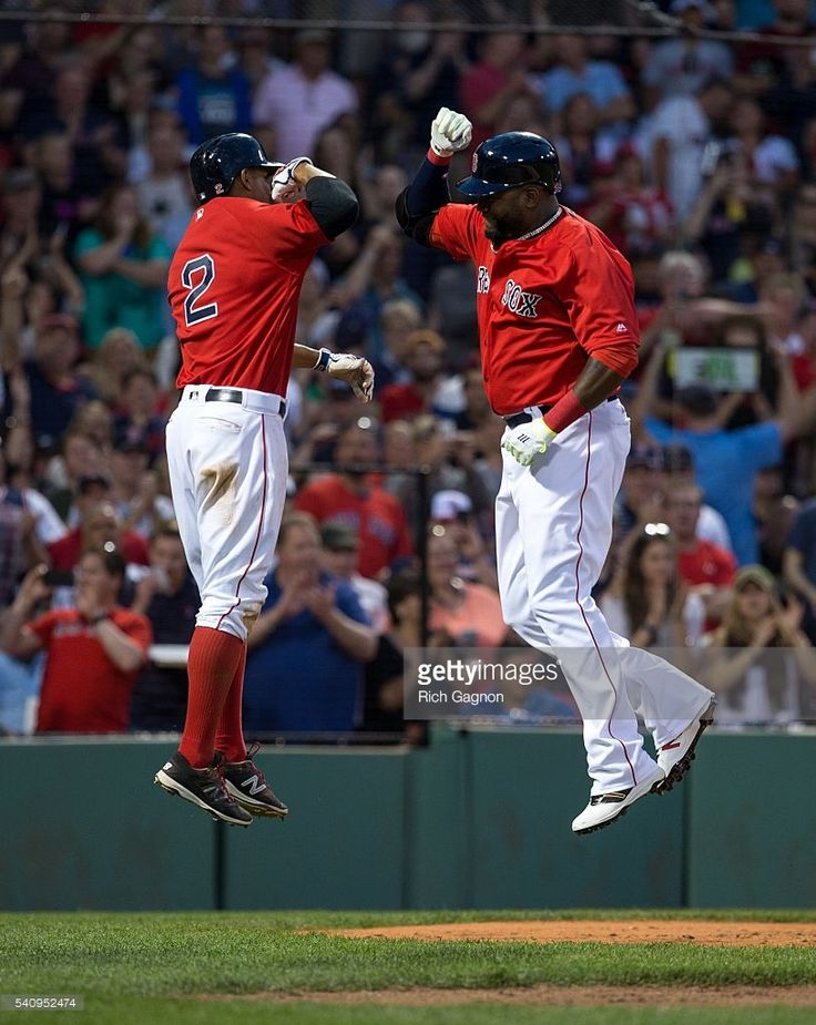 David Ortiz #34 of the Boston Red Sox celebrates with teammate Xander Bogaerts…