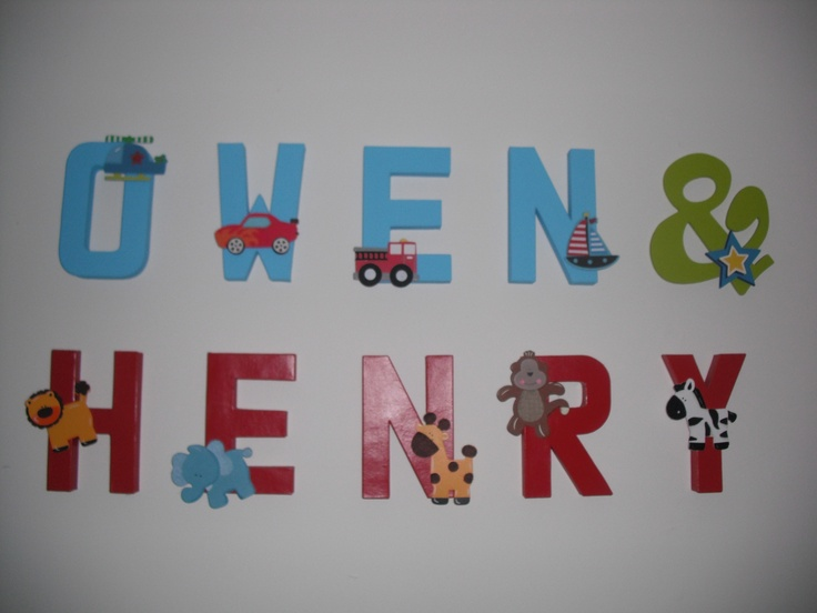 nursery letters paper mache letters painted with wooden character embellishments all from hobby lobby