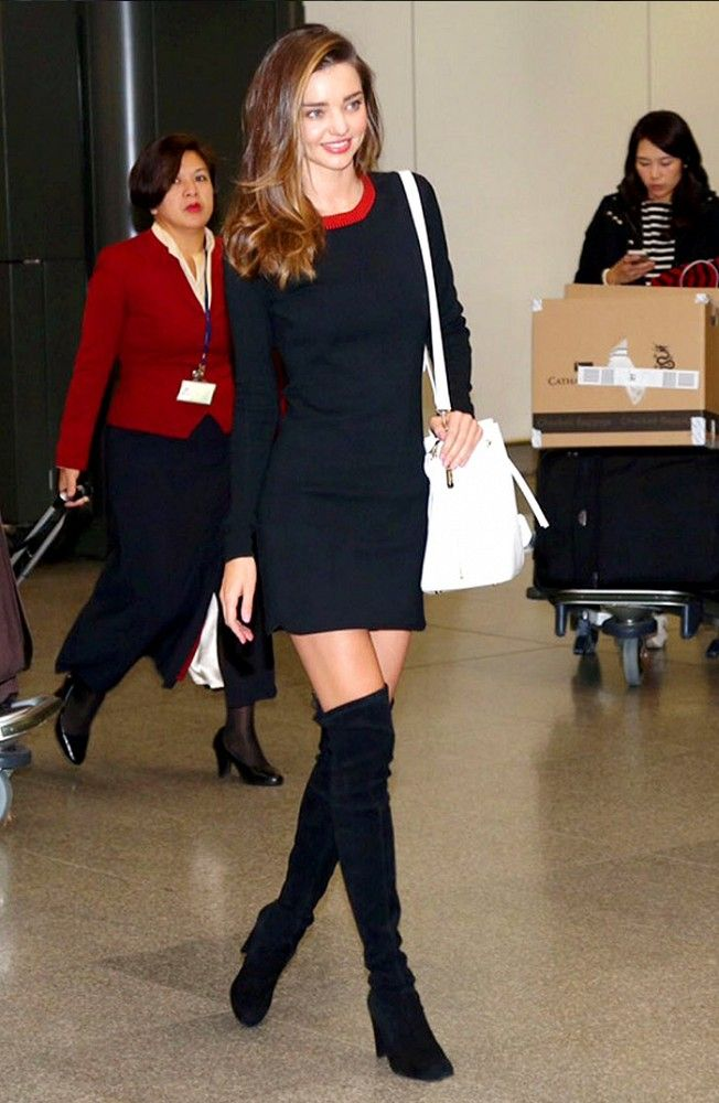 Miranda Kerr in a flirty navy mini dress and thigh-high black boots