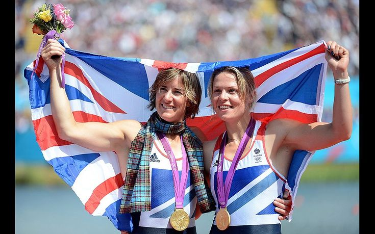 Katherine Grainger and Anna Watkins of Great Britain celebrate with their gold medals draped in a Union Jack during the medal ceremony for the Women's Double Sculls final on Day 7 of the London 2012 Olympic Games