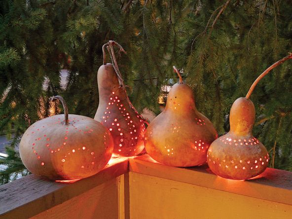 Festive outdoor lanterns, using Gourds and a drill to create patterns for light to shine through.