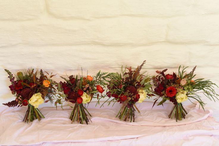 September Wedding, spring flowers, bridesmaids bouquet, double tulip, ranunculus, pepper tree, snapdragon, deep reds, burgundy, cream