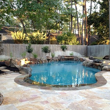 Peaceful and relaxing backyard oasis with stone work. -Parra Electric, Inc.