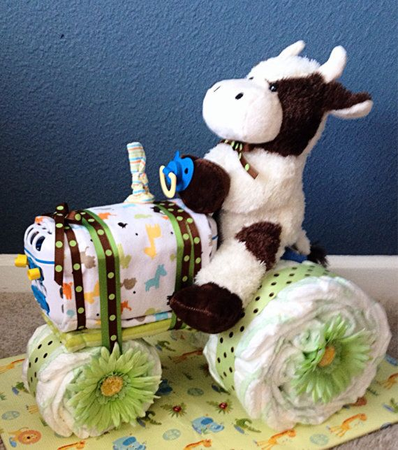 Perfect gift or baby shower centerpiece! Absolutely wonderful for a farming family! Especially a cattle farmer. It comes fully gift wrapped and includes:  • 28 diapers • 3 baby wash cloths • 1 pacifier • 1 baby utensil dishwasher basket • 2 receiving blankets • 1 pair of socks • 1 stuffed for driver