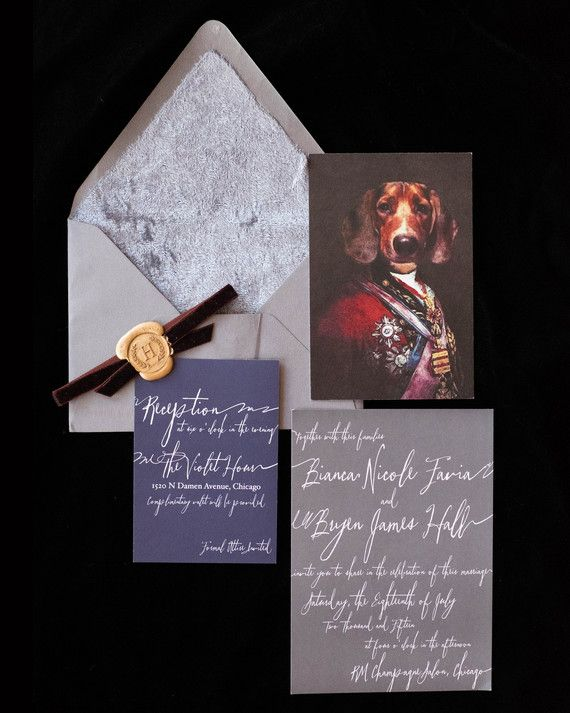 With the help of Sarah Drake Design, the couple designed a dark, romantic stationery suite complete with a velvet envelope liner, gold wax seal, and burgundy velvet ribbon. A portrait done by The Regal Beagle of their dog, Benny, on the Duke of Wellington's body served as the RSVP postcard.