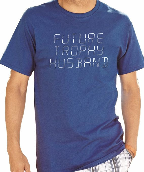 Buy 2 T-Shirts and get the 3rd FREE! *Add 3 T-Shirts To Your Shopping Cart, Apply the coupon code ( FreeTee ) at checkout! (coupon value $12.95 USD when buying 3 items)   Valentines Day Gift Future Trophy Husband Mens T shirt Fathers Day Gift Wedding Gift Husband Gift T-shirt Best Dad Gift cool shirt  All our t-shirts are screen printed by hand and made to order on 100% Cotton Tees. All shirts are screen printed in a smoke free environment.  Only the best screen printing inks are used. I…