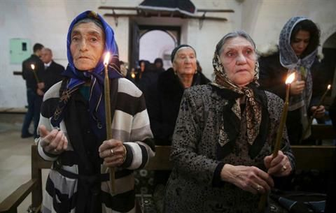 Syriac Christians from Turkey and Syria attend a mass at the Mort Shmuni Syriac Orthodox Church in the town of Midyat, in Mardin province of southeast Turkey in this February 2, 2014. (REUTERS/Umit Bektas) Read more: http://www.dailystar.com.lb/News/Middle-East/2014/Mar-01/248885-generations-on-christians-fleeing-syria-return-to-turkey.ashx#ixzz2ulPIKPk2  (The Daily Star :: Lebanon News :: http://www.dailystar.com.lb)