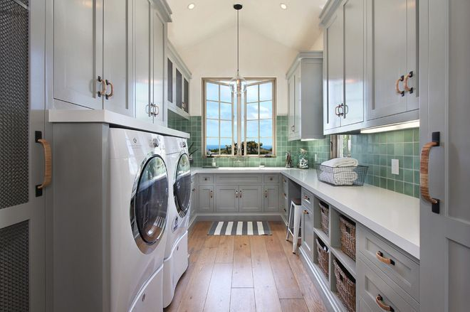 Mediterranean Laundry Room by Brandon Architects, Inc.