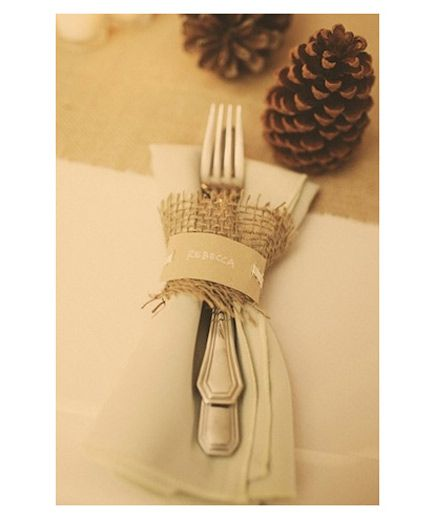 Fall wedding place setting with burlap and pinecones