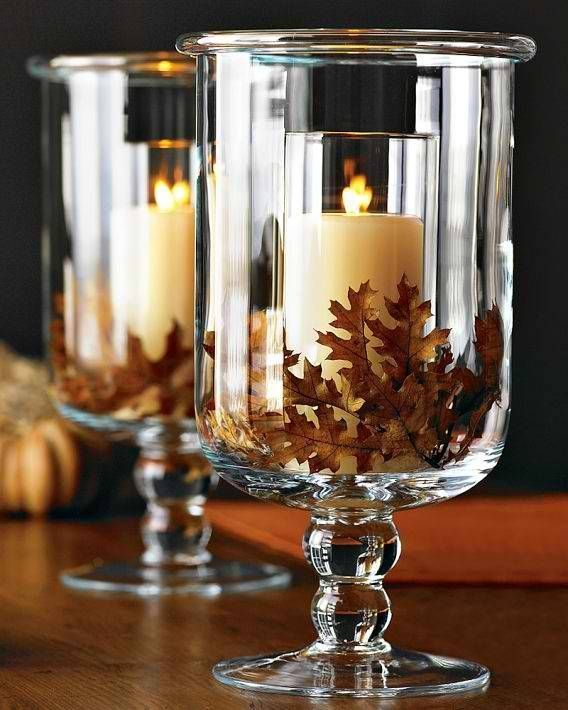 Maybe instead of leaves, some type of flower and floating candles in the center candleholder.Candles - 34 Lovely Fall Tablescapes