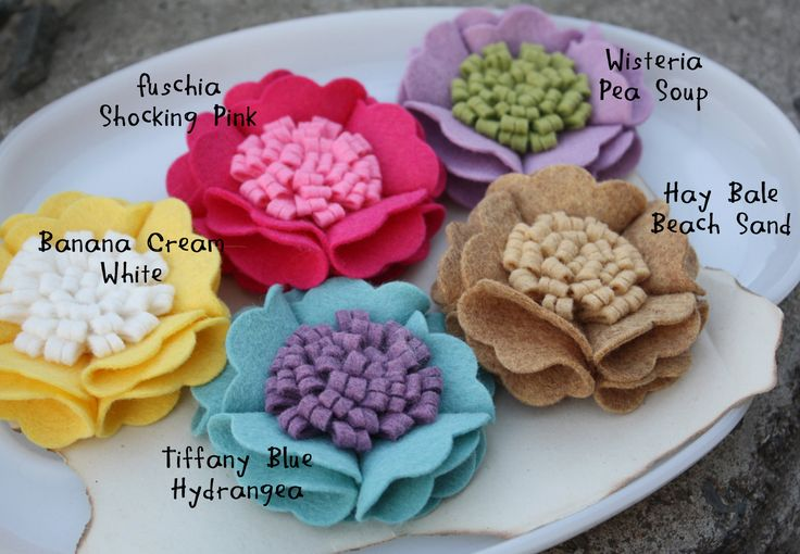 Wool Felt Flowers--scalloped circles folded with contrasting felt roll flower in center.  Cute idea for clips and headbands.