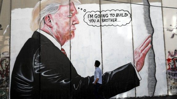 Banksy didnt paint these Trump murals in the West Bank but theyre still turning heads