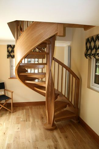 Oak spiral staircase with twisted column and side string.