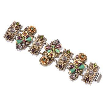 The Sweet Romance bracelet links are created with dimensional elements, including flowers set with crystal and three dragonflies with beaded wings