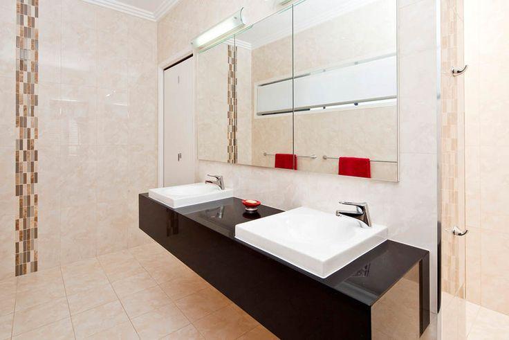 Palm Beach luxury home bathroom with dual basins. #bathroom #luxuryhome #design